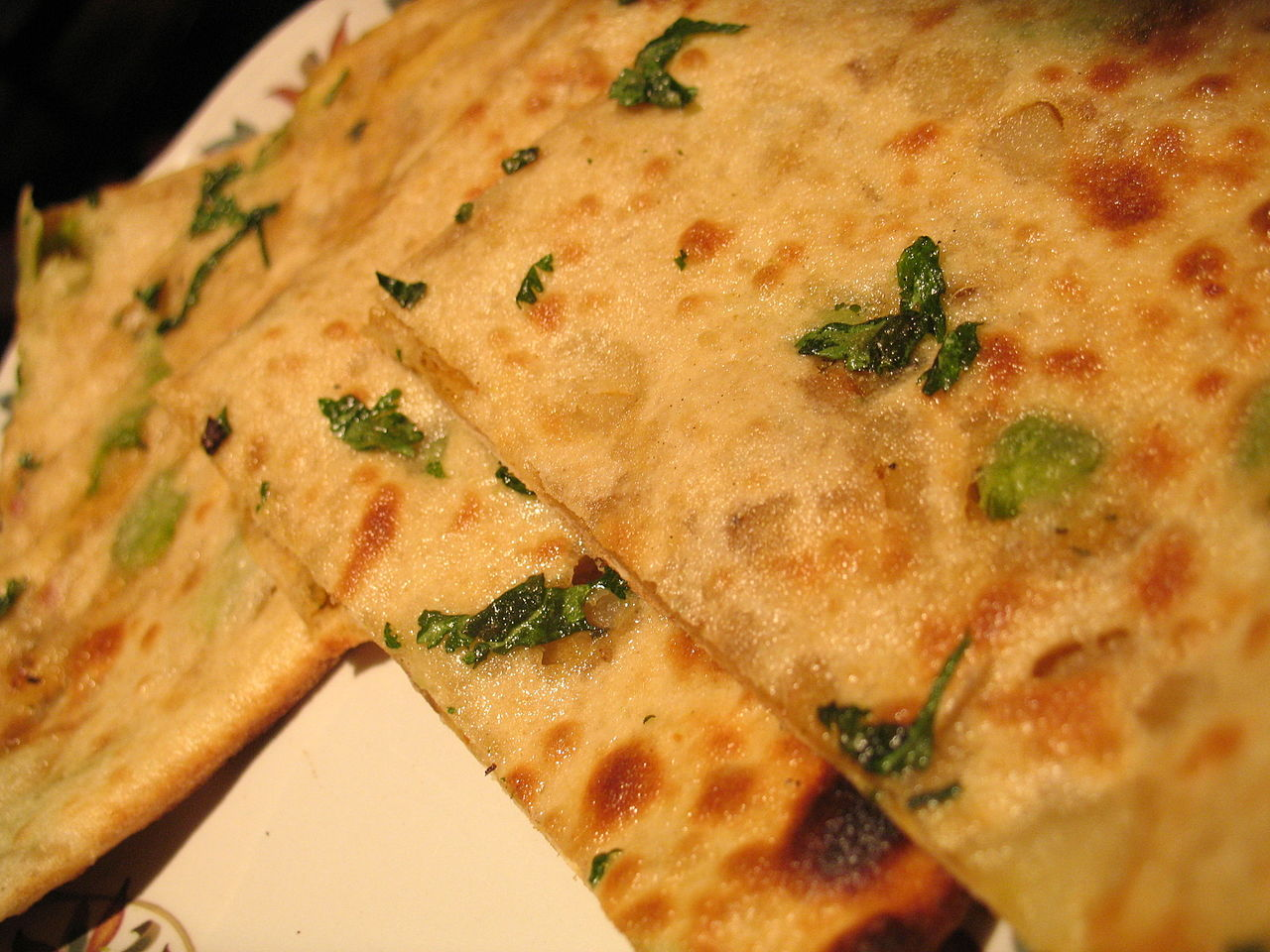 Aloo Paratha Lying on a Table